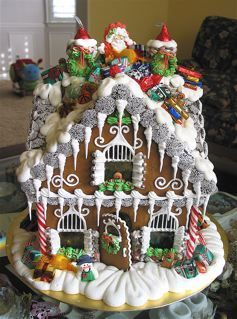 what a beautiful gingerbread house! I would love to make one, but mine would probably look like a big pile of poop!:
