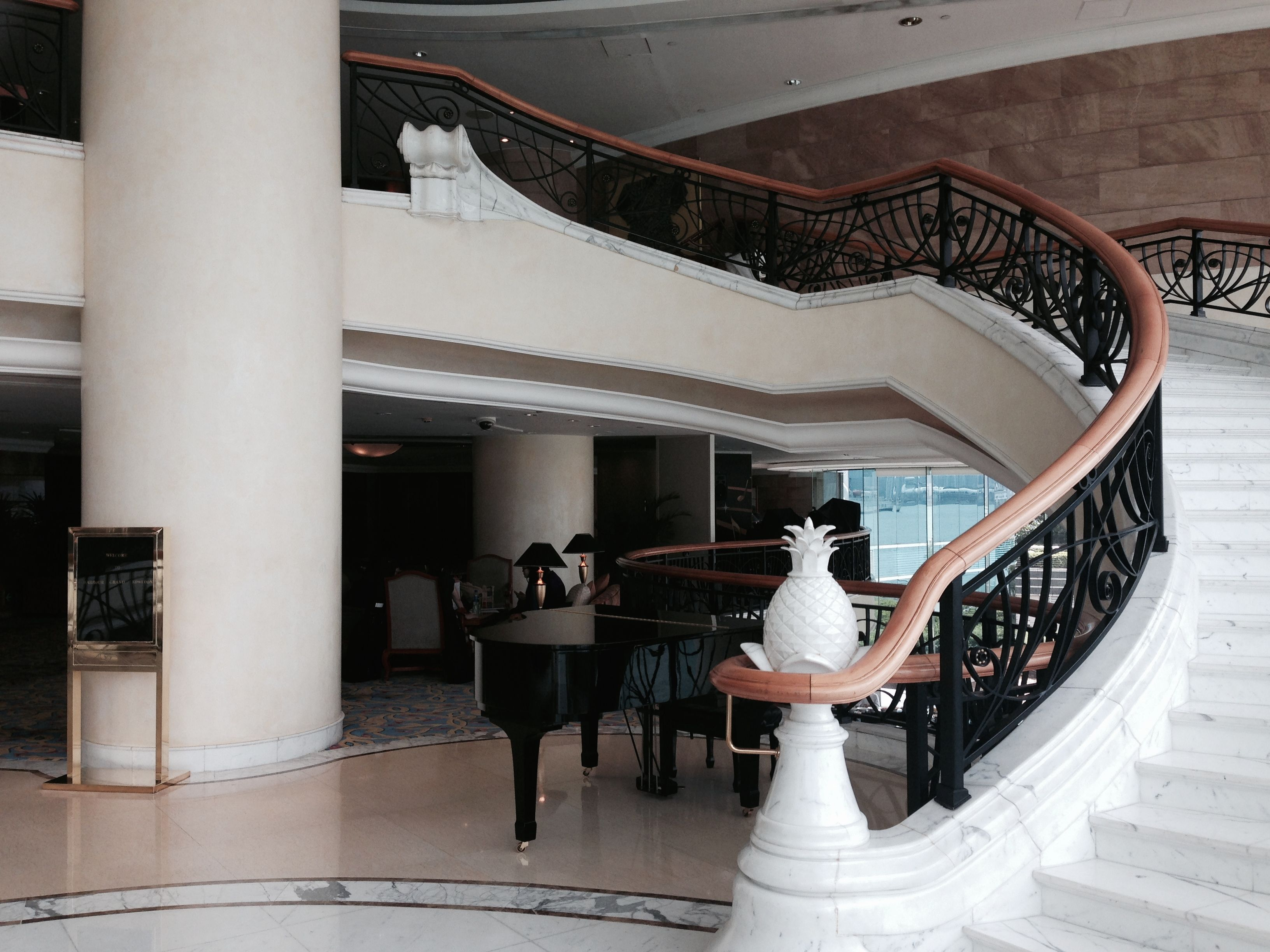 Baby Grand Piano and staircase up the