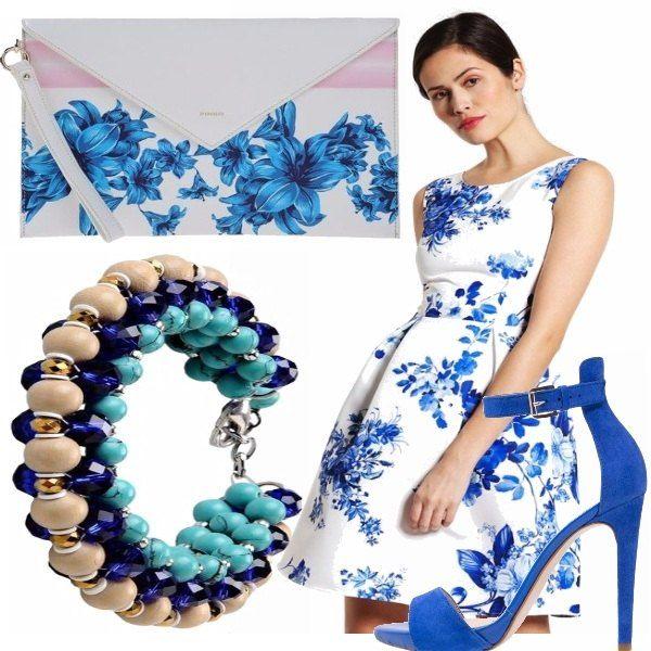 e5c4f6e71201 Un bellissimo vestito fondo bianco e fiori blu