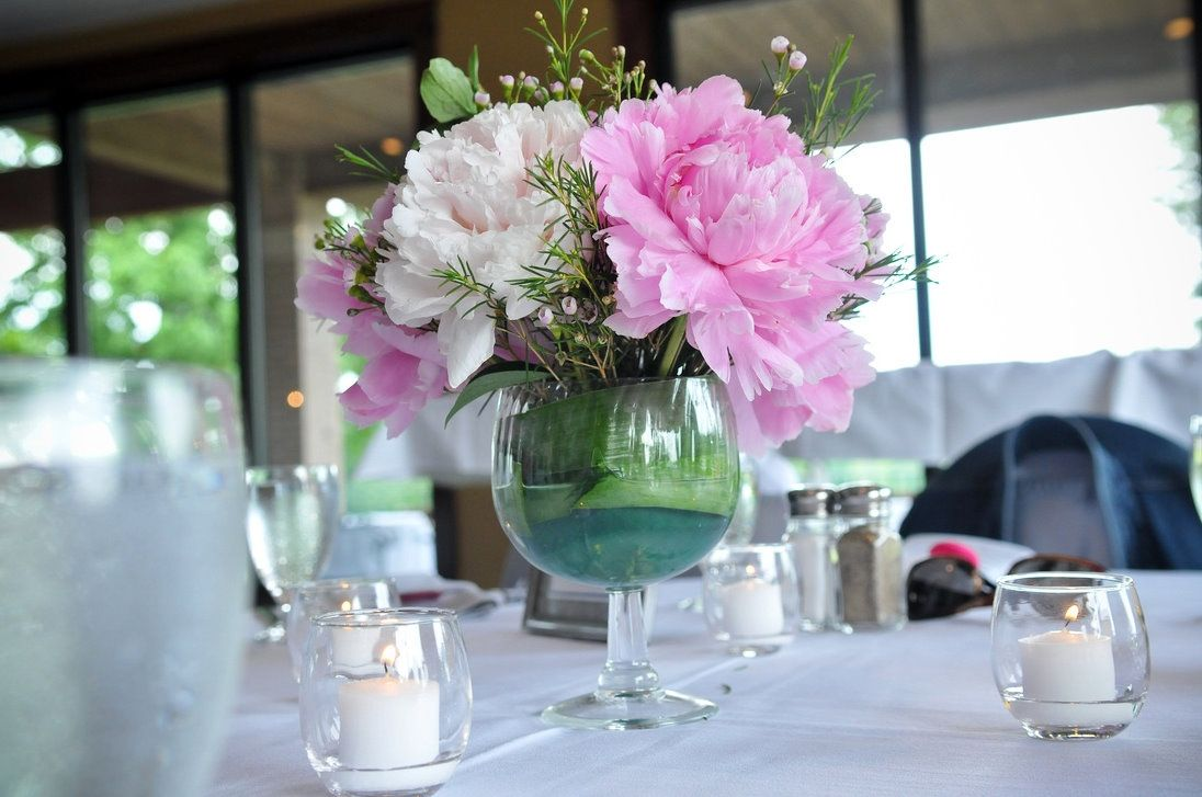 This wedding table centerpiece in a large wine glass type