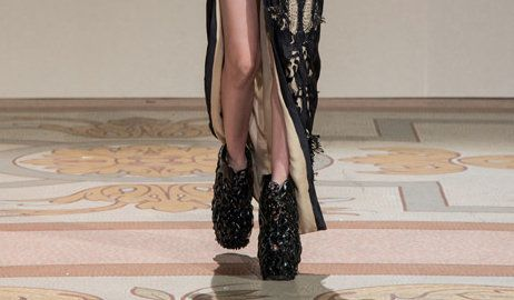 Fashion designer Iris van Herpen and shoe designer Rem D Koolhaas have collaborated to create 3D-printed shoes that look like tree roots. The shoes were presented at Paris Fashion Week during Iris van Herpen's couture show.
