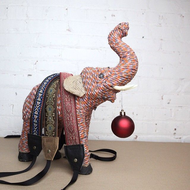 This little guy dressed in our camera straps says Happy Monday! #porteen #porteengear #porteenbagbuilder #leathercamerastraps #handmade #holidayseason #grandrapids #localfirstwestmi #elephant #giftideas #create #inspire