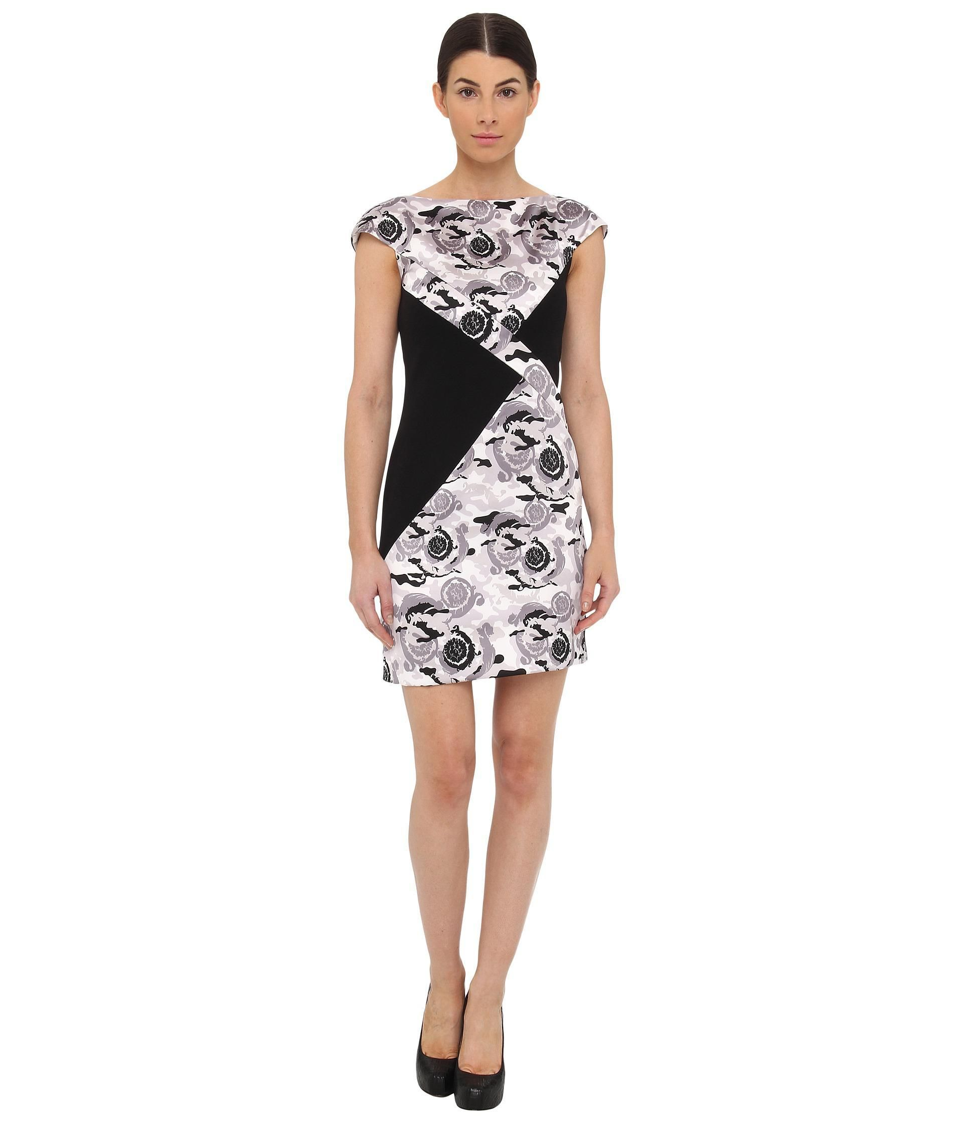 Look exquisite in this remarkable Versace Collection™ dress.. Contrasting printed and solid panels...