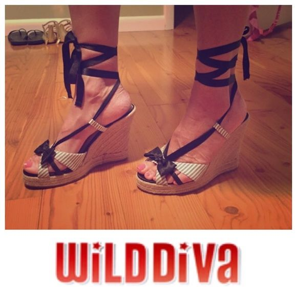 "Striped Canvas Wedges with Ankle Tie Gently worn! EXTREMELY CLEAN! Black and white striped canvas straw wedges with satin bow detail on front!! 4"" wedge, satin ankle tie that can be tied in the front or back (I have pictured both ways!) Wild Diva Shoes Wedges"