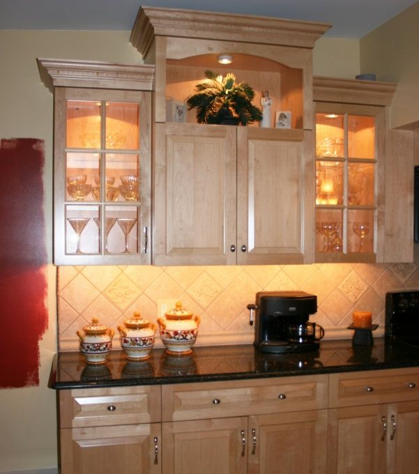Like the backsplash with the light maple cabinets and dark ...