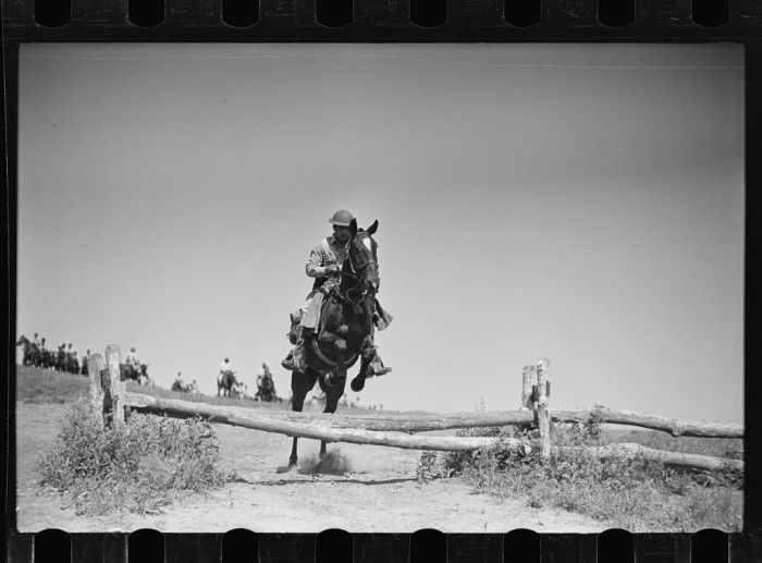 """WWII KS """"Soldiers of a cavalry machine gun platoon going over an obstacle during a field problem."""""""