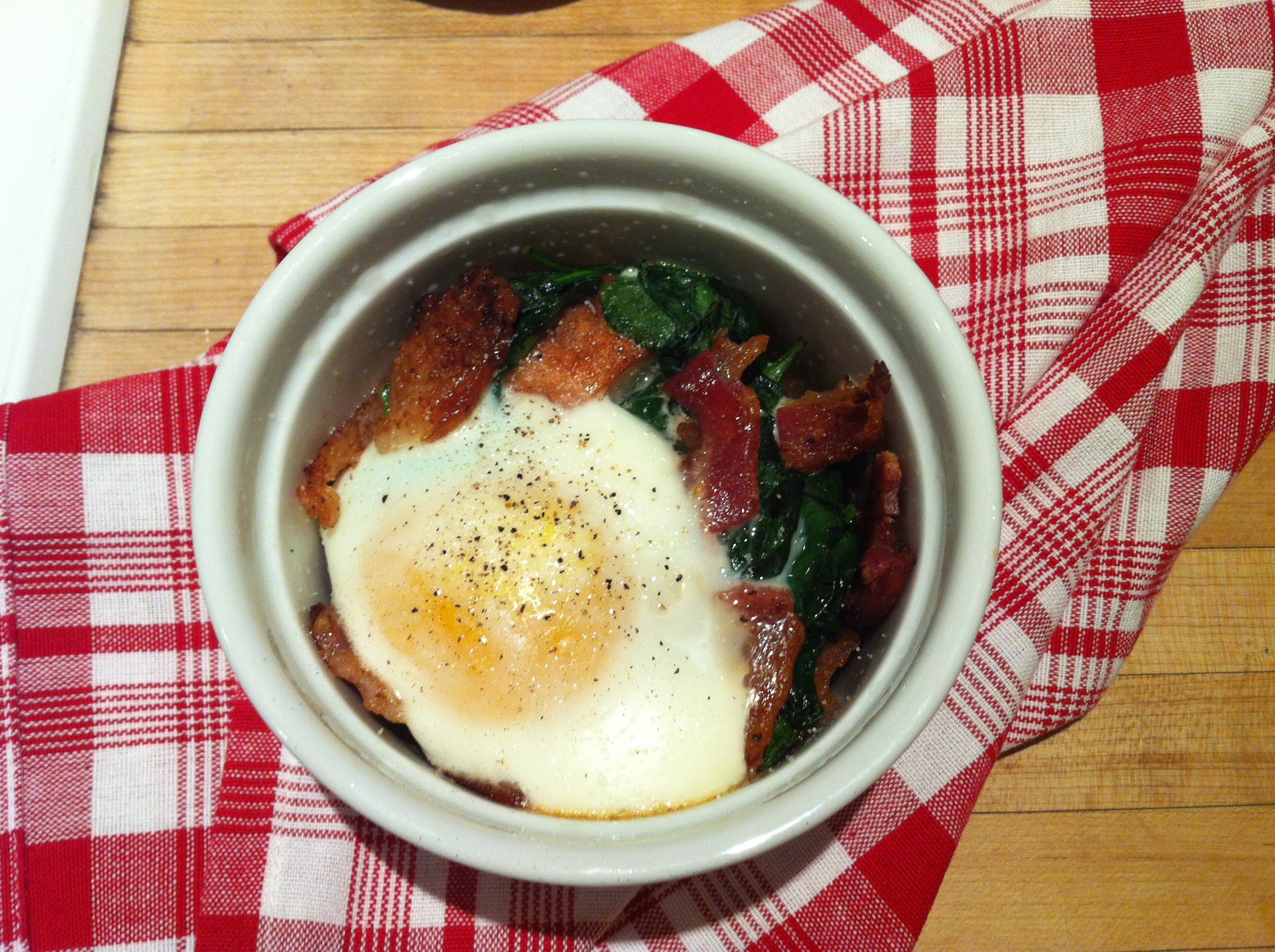 Baked Eggs with Spinach & Bacon...also french bread, tomato preserves and cream.  All that packed into a single-serving ramekin makes for a tasty, simple and impressive dinner {or brunch}.