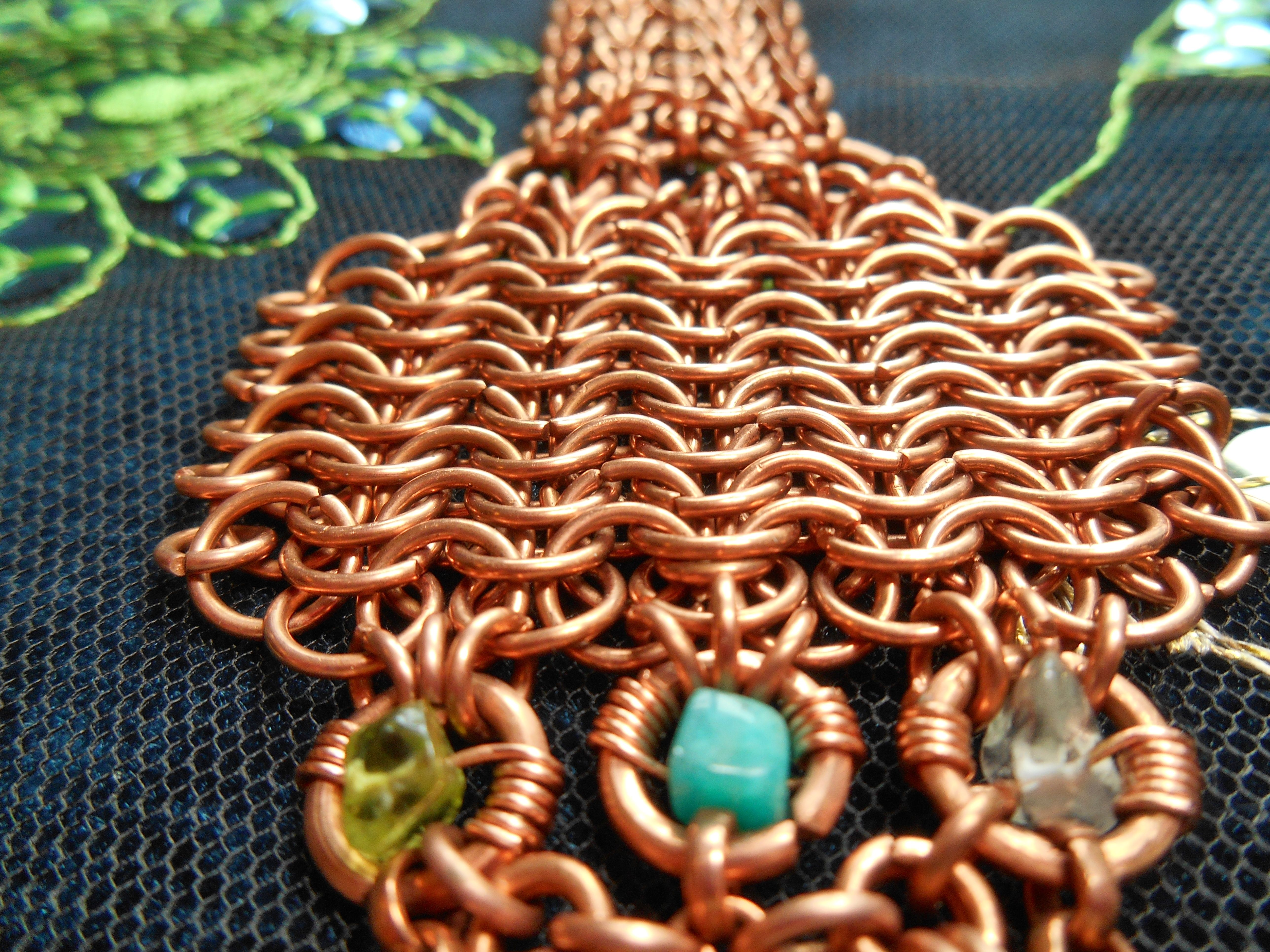copper chainmaille cuff w/peridot, amazonite and clear quartz crystal gemstones https://www.etsy.com/ca/listing/214103008/unique-handmade-copper-chainmaille-cuff?ref=shop_home_active_13