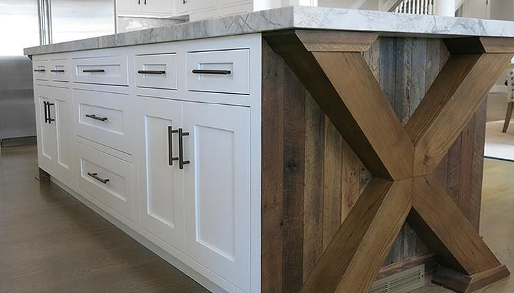 Amazing Kitchen Features An X Based Island Fitted With Reclaimed Wood  Planks And White Shaker Cabinets