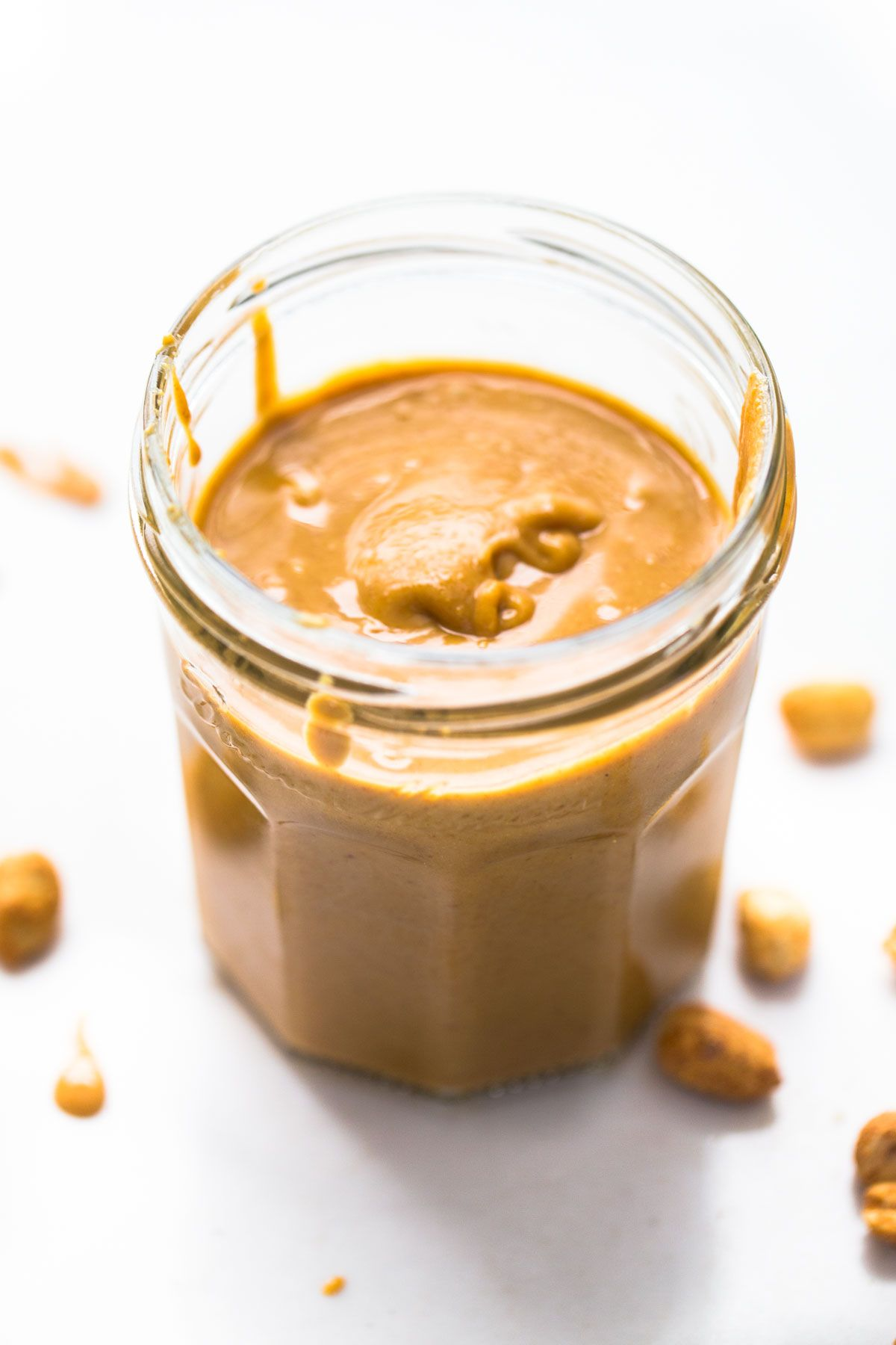 Homemade Peanut Butter recipe - the BEST creamy, melty texture! All you need is peanuts and a food processor.   pinchofyum.com
