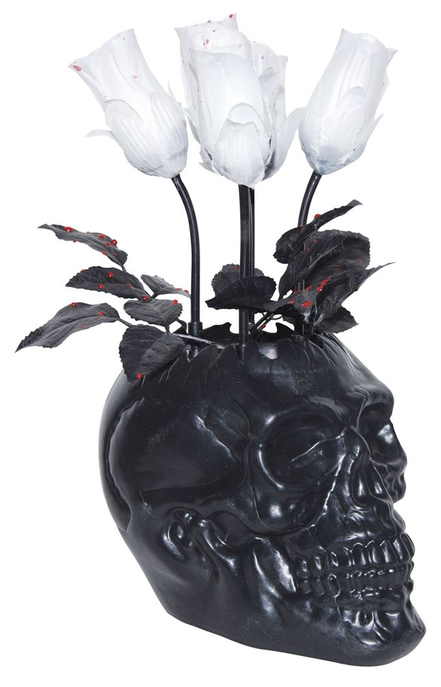 Black skull vase... The purple eyeball flowers would look interesting in this.