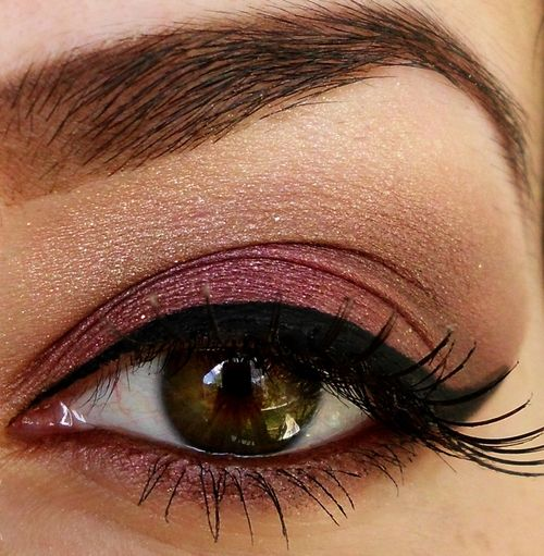 Saddle in the crease, Amethyst and Raspberry Truffle on the lid, thick cat eye, mascara, filled brows