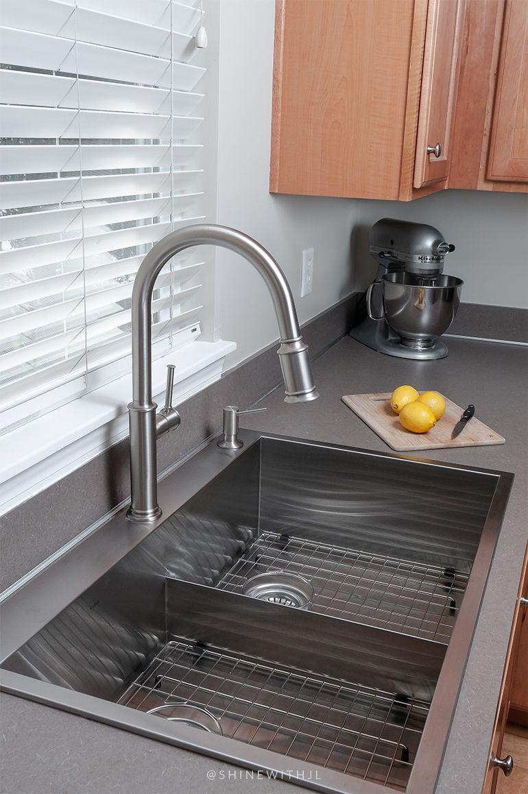Stainless steel low divide split kitchen sink measuring 33 ...