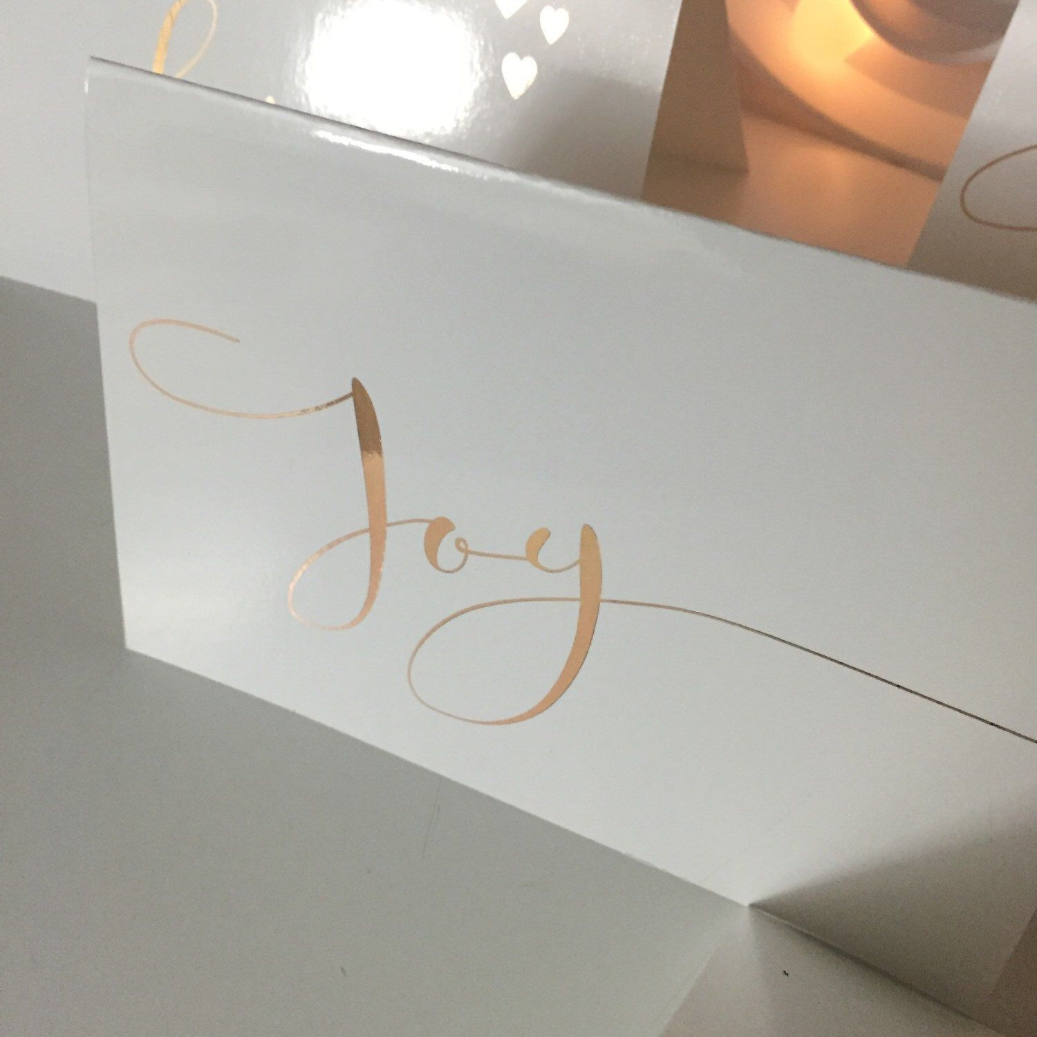 A personal favourite from my Etsy shop https://www.etsy.com/au/listing/256371079/joy-script-christmas-card-with-rose-gold