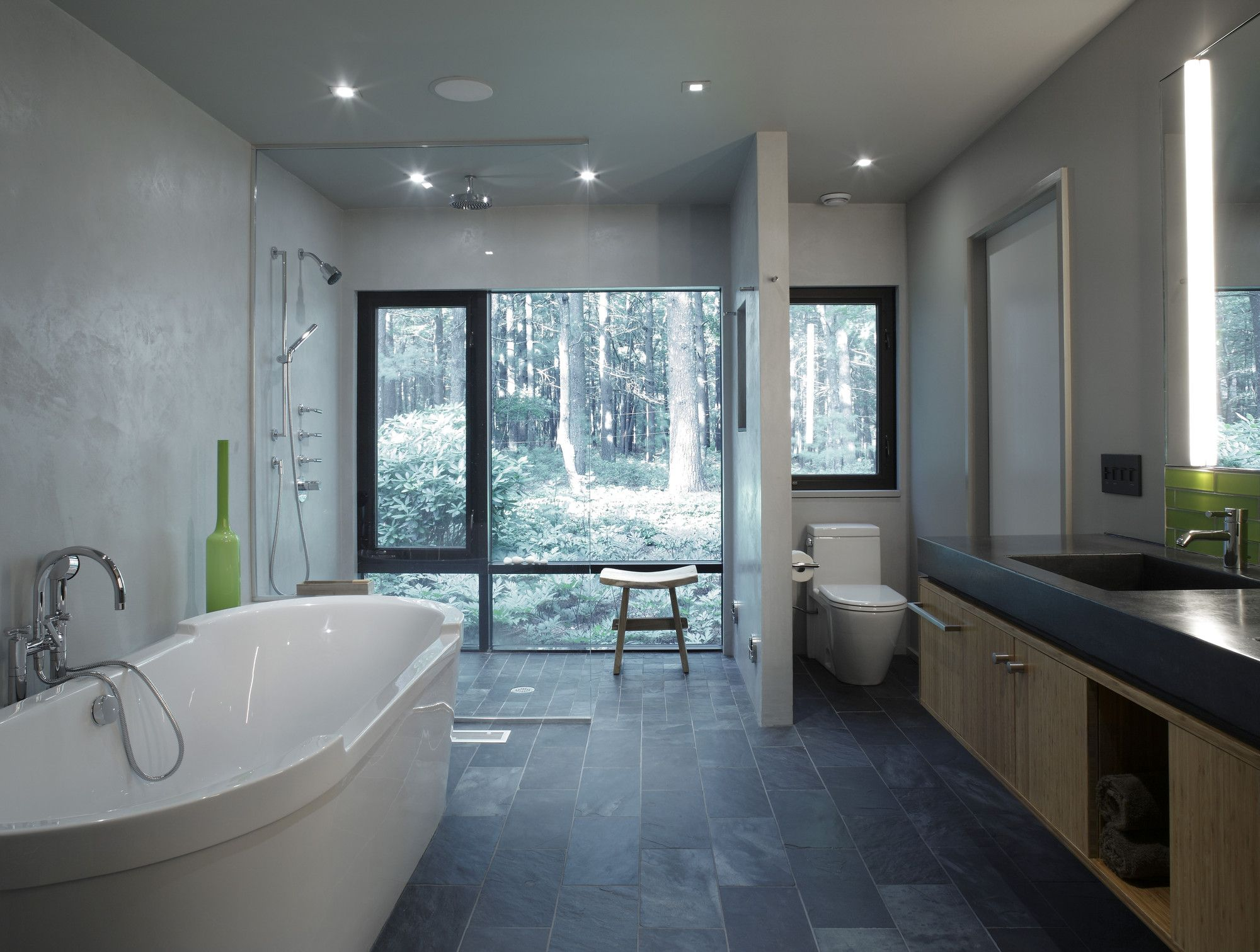 Bathroom Among White Bathtub Beside Shower Area Also Wooden Chair ...