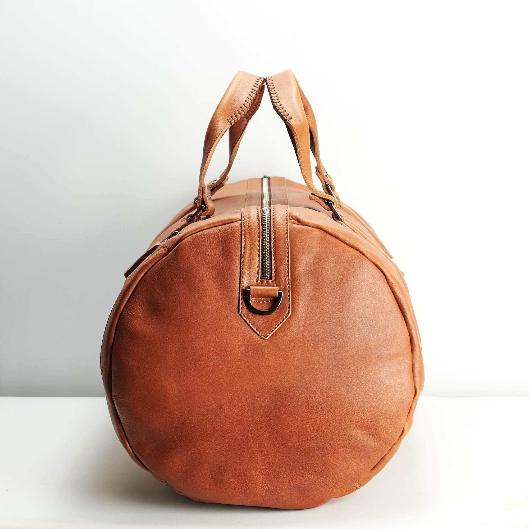b6321bbce133 Substantial Leather Duffle Bag · Tan by Capra Leather