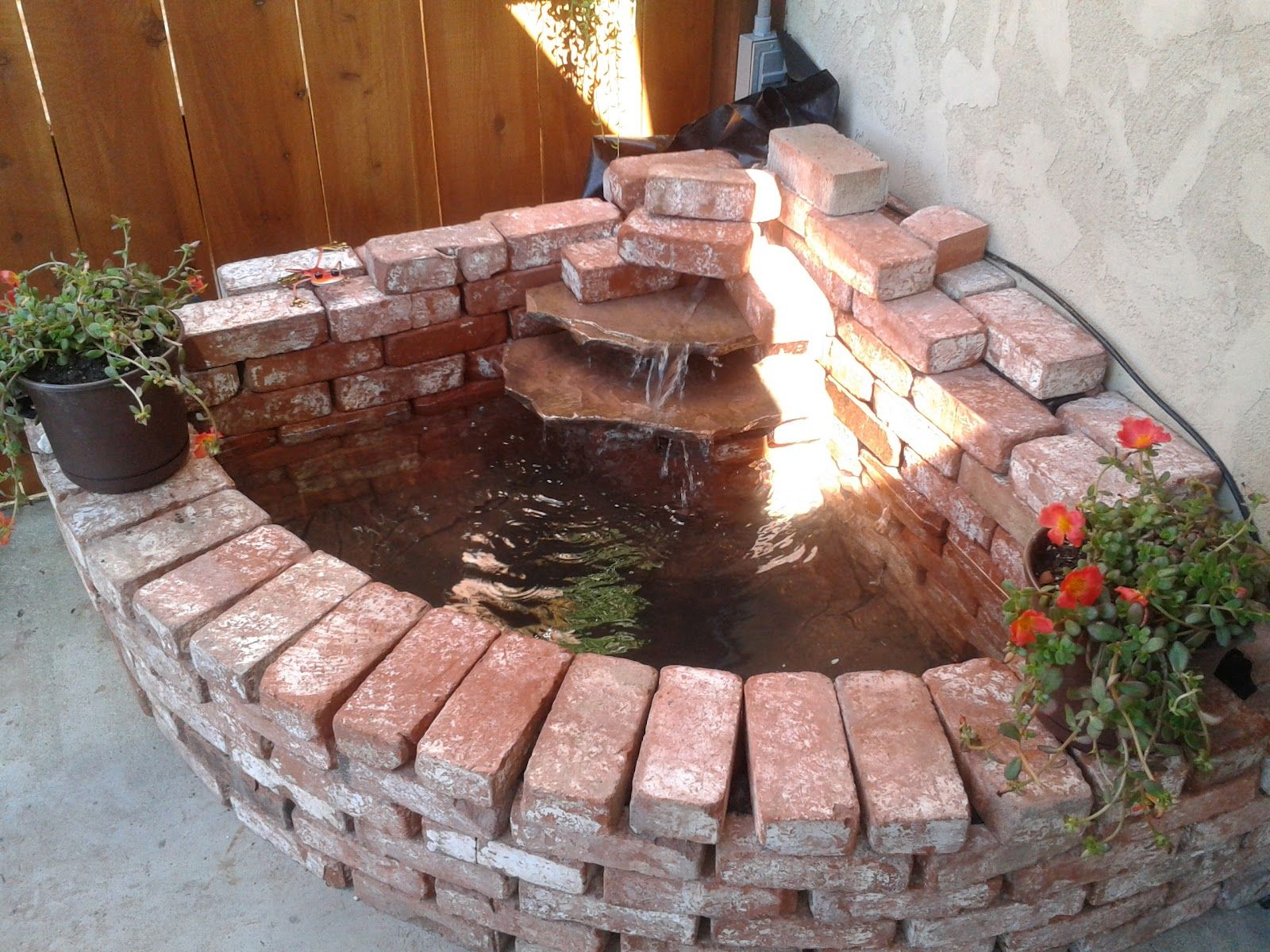 How to build your own brick waterfall | Diy garden decor ...