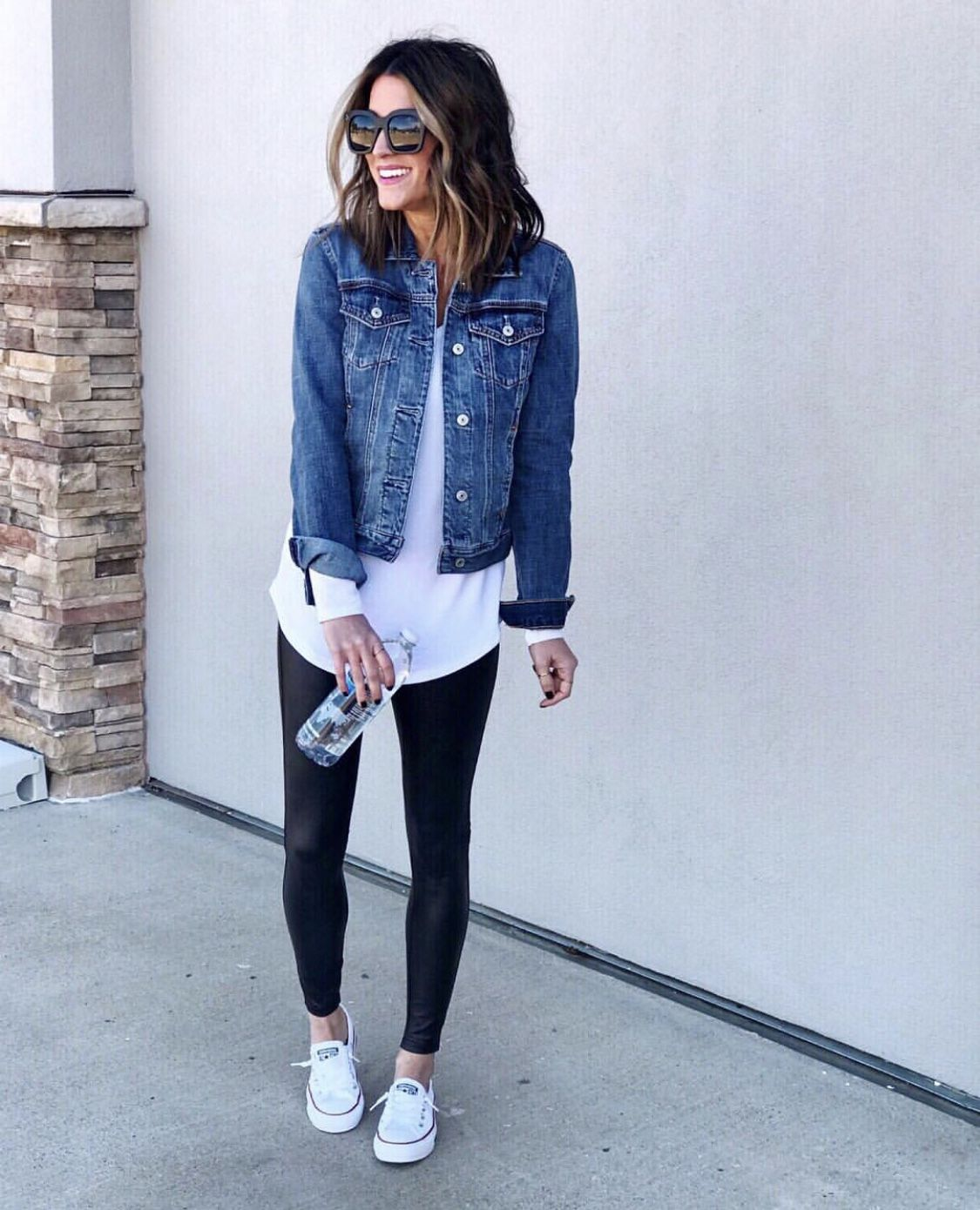 30 Ways To Style A Denim Jacket The Sister Studio Outfits With Leggings Camping Outfits For Women Denim Fashion [ 1390 x 1125 Pixel ]