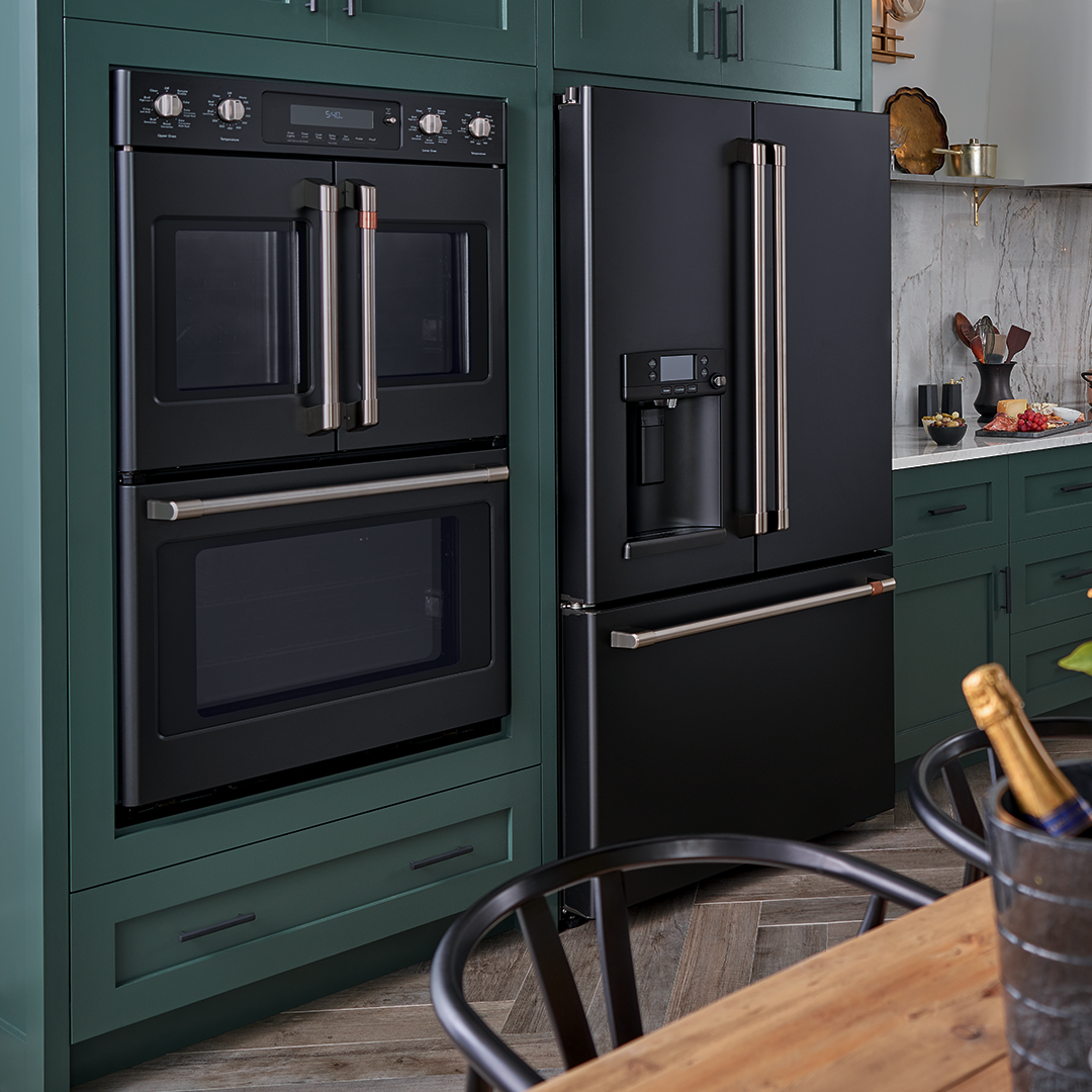 Green Kitchen Cabinets With Ge Cafe Matte Collection In Black With Brushed Stainless Steel Green Kitchen Cabinets Kitchen Cabinet Design Black Kitchen Cabinets