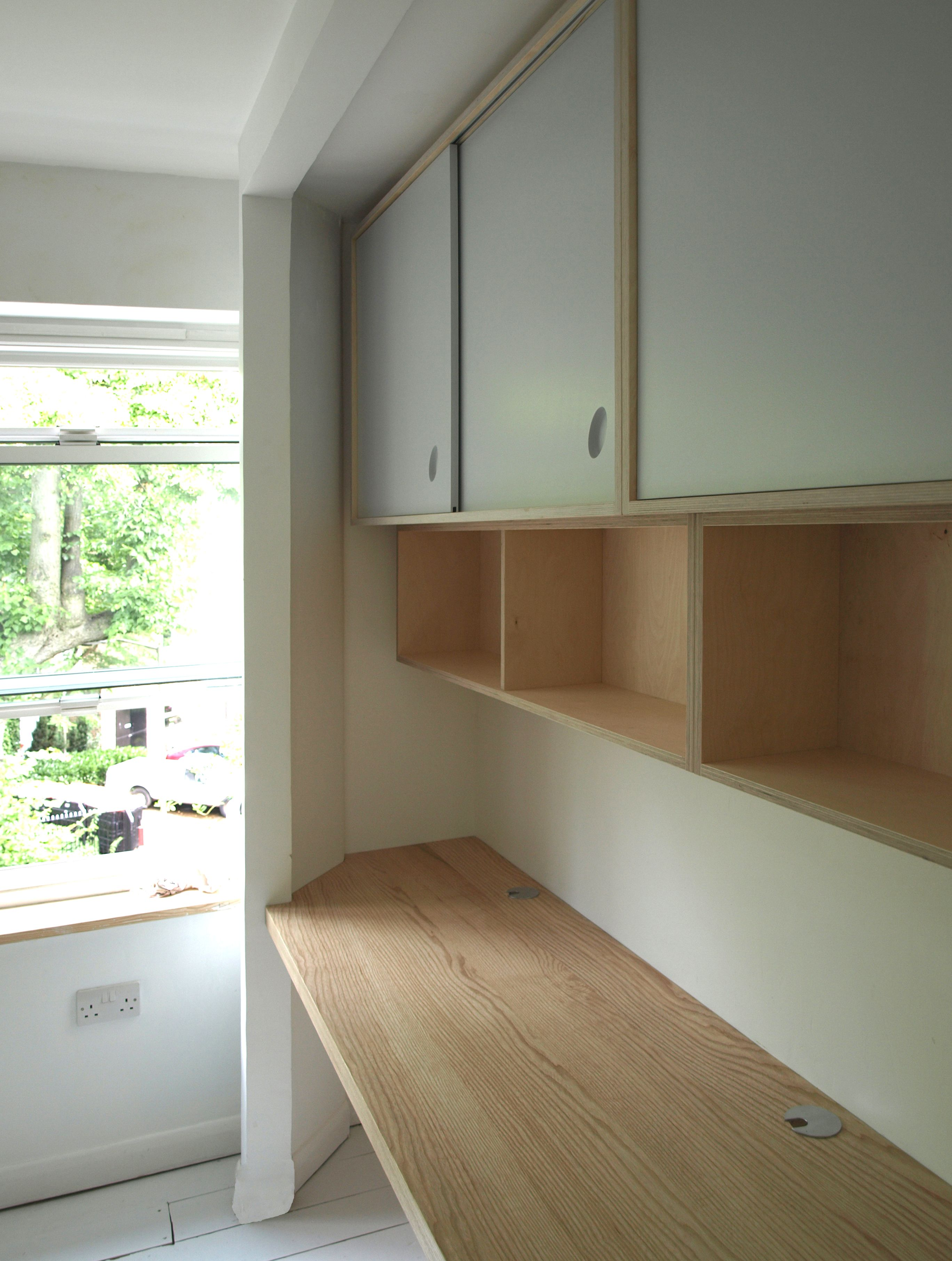 Wall Mounted Floating Birch Plywood Shelves And Cupboards With Painted Sliding Doors Desk In English As Plywood Shelves Plywood Wall Paneling Plywood Kitchen