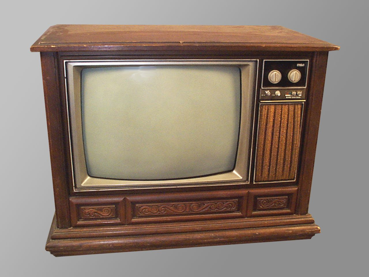 Television sets in the 1980s were often enclosed in wood for 80s furniture