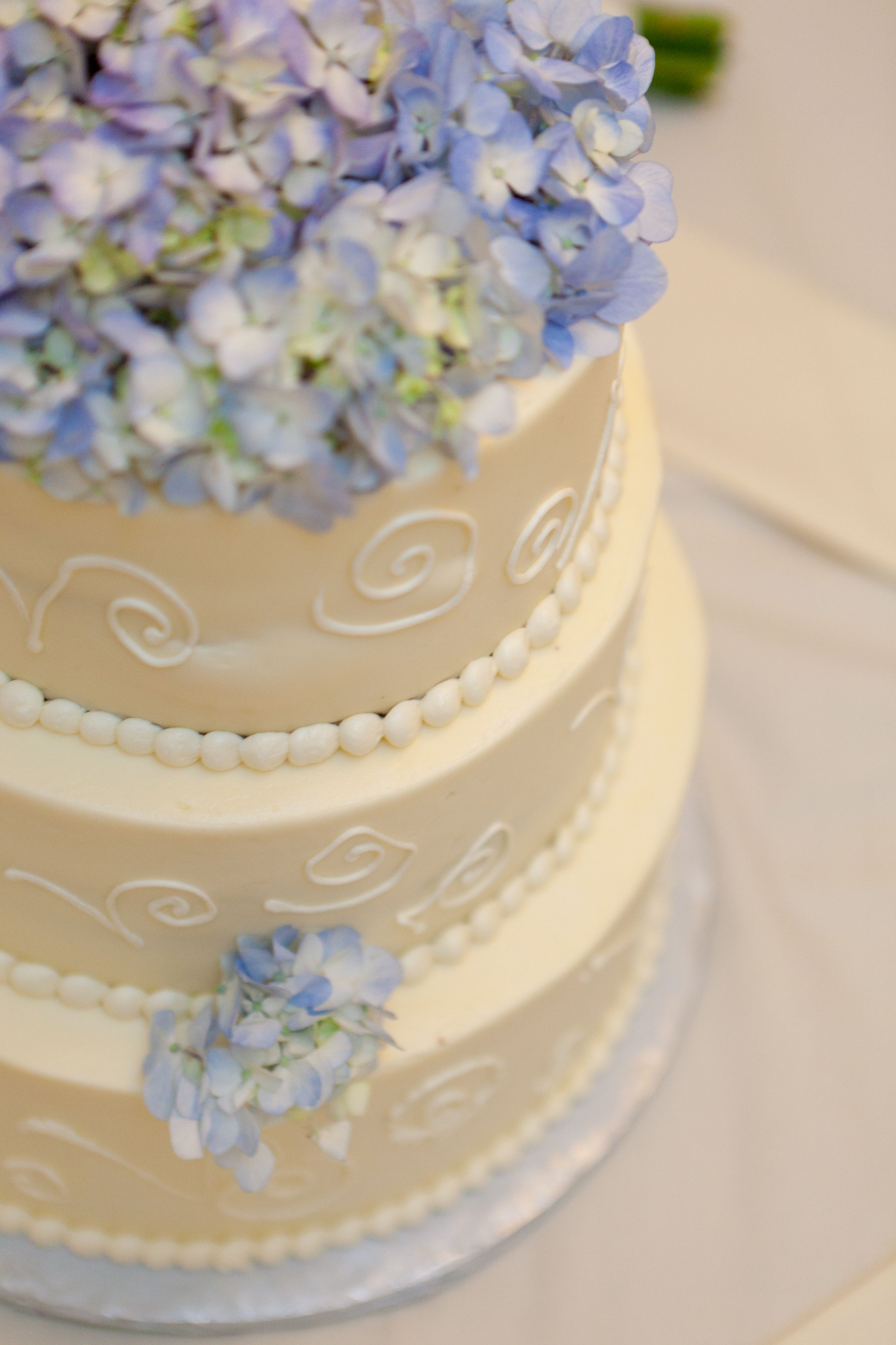 Our wedding cake was simple. Blue hydrangeas on top and