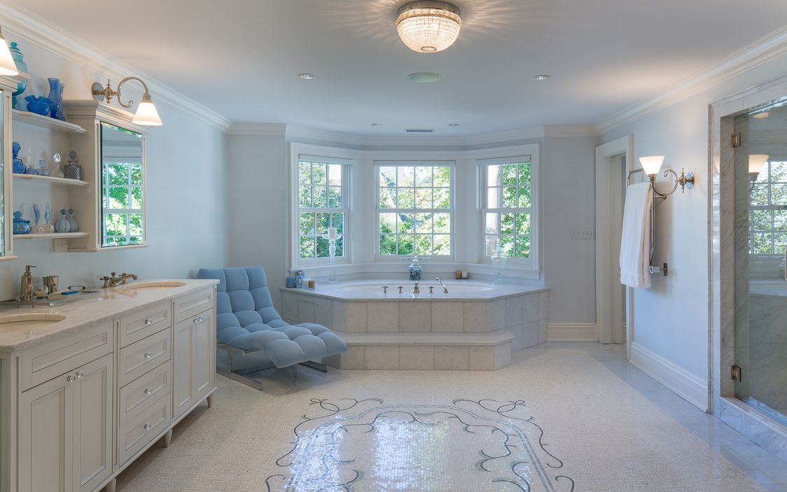An unequalled spa-bath with intricate mosaic tile floor, spa-tub ...