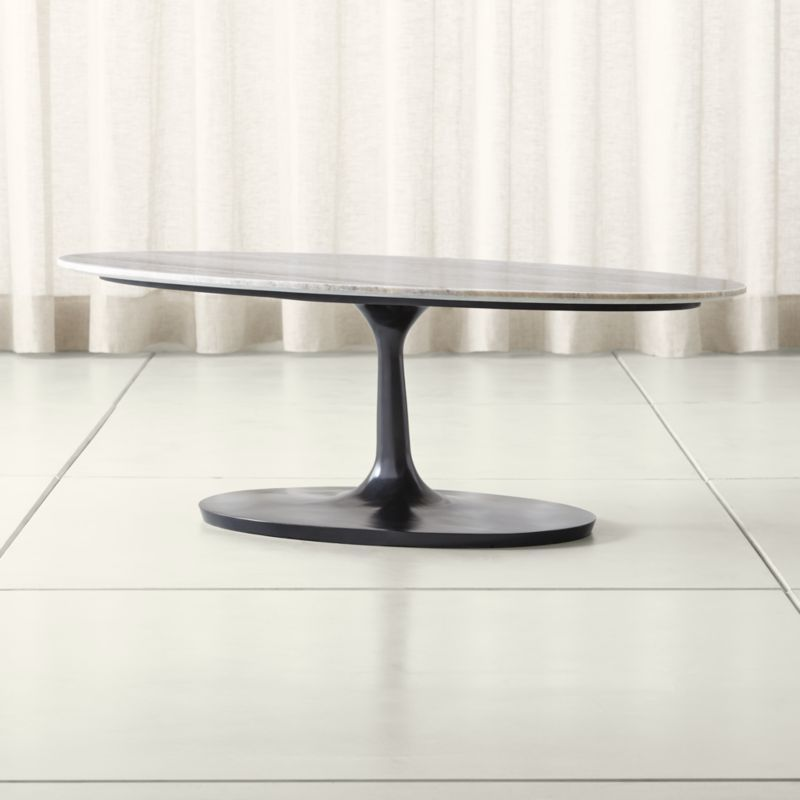Shop Nero Grey Marble Oval Coffee Table The Nero Grey Marble Oval Coffee Table Is A Crate And Barrel Exclu Oval Table Dining Marble Tables Design Coffee Table