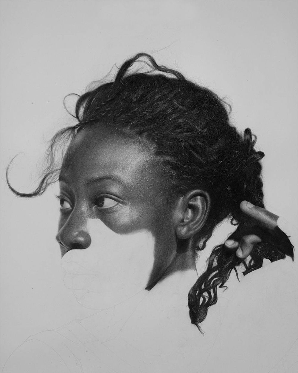 Larger than life hyperrealistic portraits rendered in graphite and charcoal by arinze stanley
