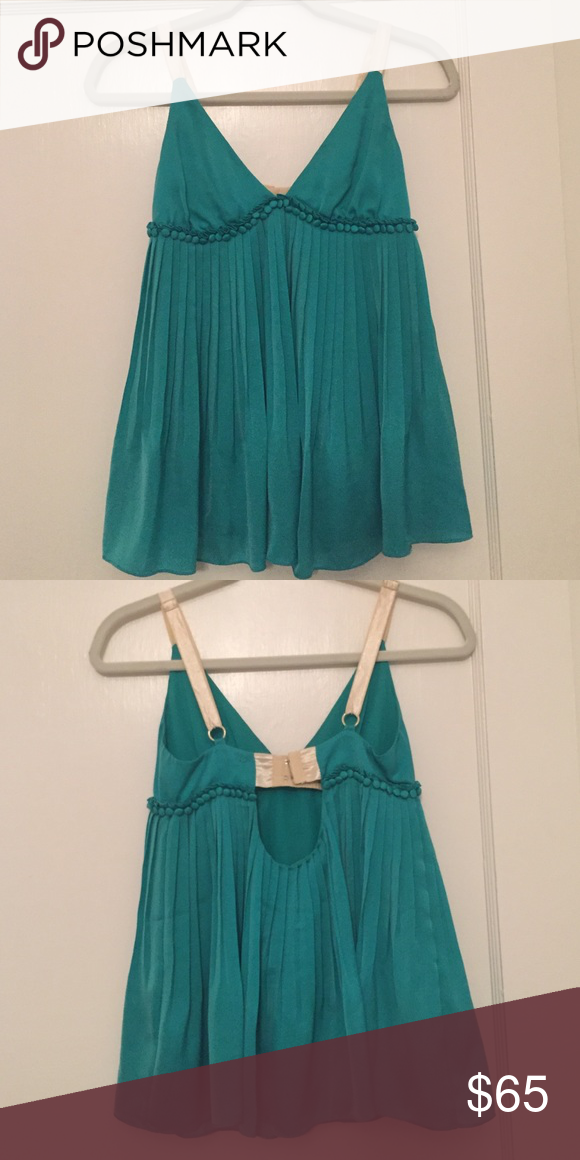 Elizabeth & James baby doll top! Amazing silk Elizabeth & James babydoll tank!! Pleated body with adjustable straps and adjustable clasp in the back Elizabeth and James Tops Tank Tops