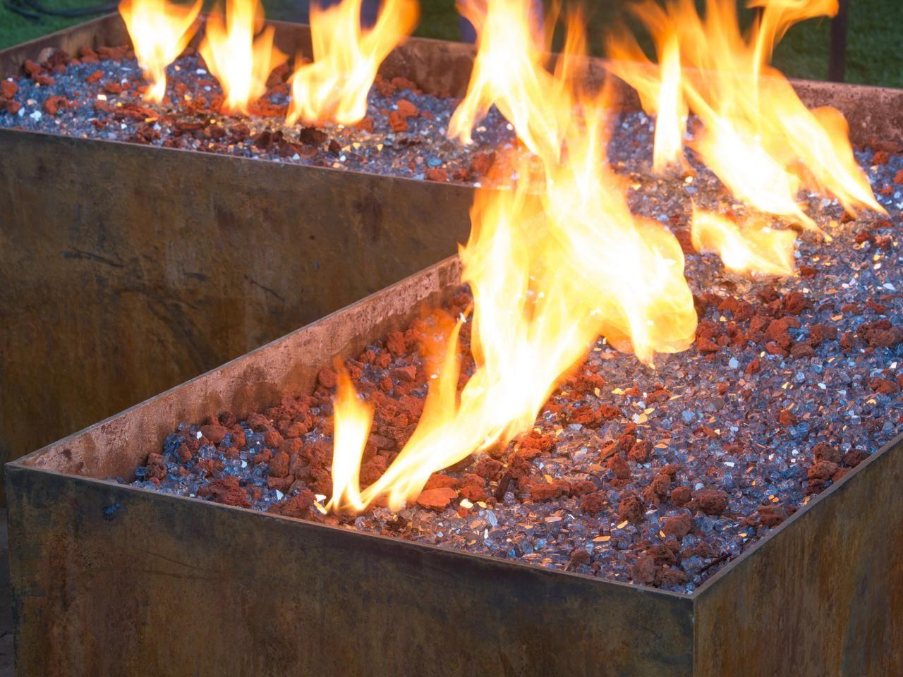 Garden fire features  Eight Backyard Makeovers from DIY Networkus Yard Crashers  Fire