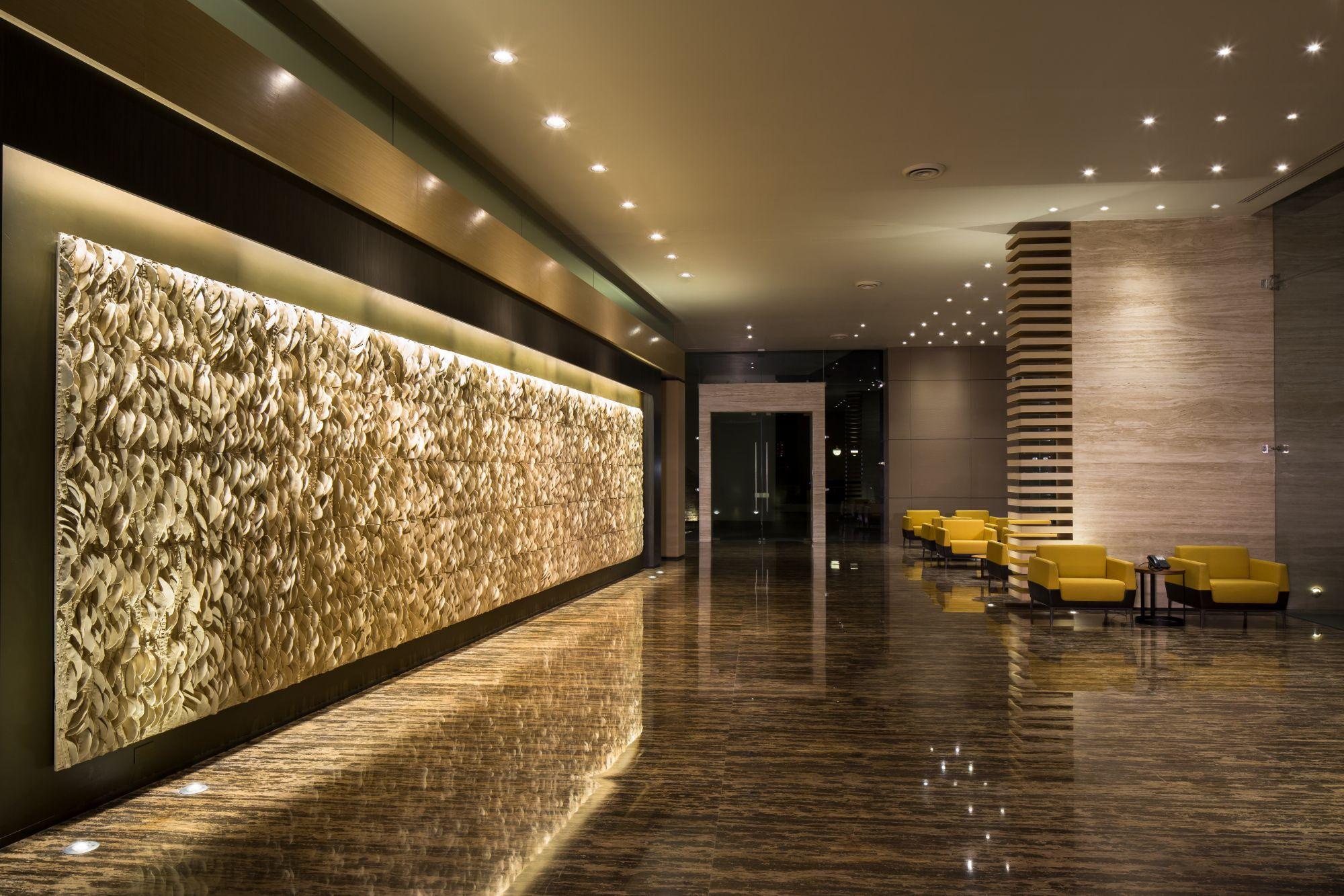 Dise amos un lobby abierto y compartido para las dos - Arquitectos de interiores ...