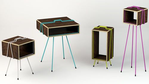 Les frères Plo . Gaspard Graulich ( furniture that functions as either side tables or display cabinets. With four variations that differ in shape and color, they are made of dark wood boards held together via an interlocking system that provides a pop of color and makes each piece stand out)