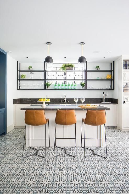20 Glorious Contemporary Home Bar Designs You Ll Go Crazy For: Stylish Basement Wet Bar Features Three Brown Leather Counter Stools Placed On Black And Blue