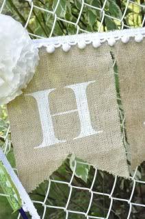 burlap and paper wedding banners {tutorial} | Little Birdie Secrets. Per chi non riesce a reperire in Italia la vernice di Martha Stewart, sappiate che il Keltan Satinato la sostituisce alla grande! Lo trovate su http://www.coloraletueidee.it