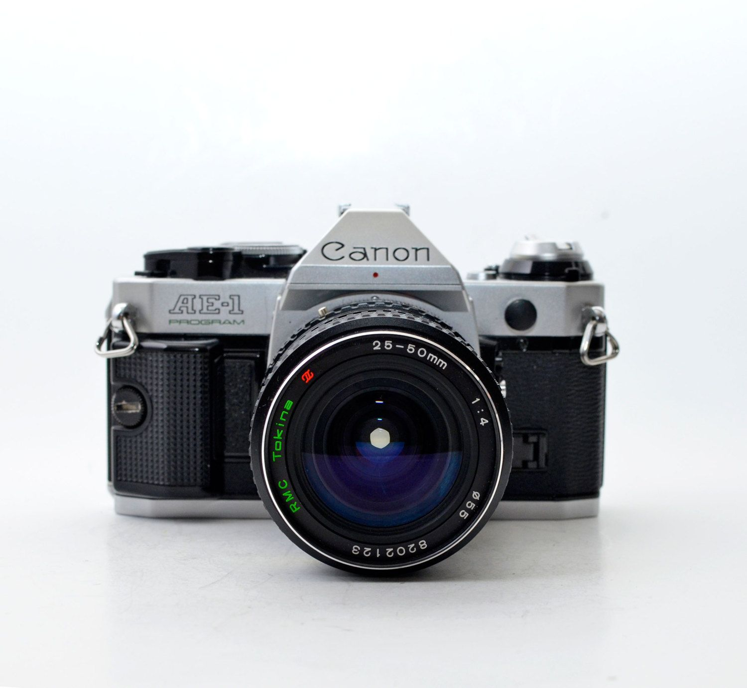 Canon AE-1 Program 35mm Film SLR Camera with Tokina RMC 25-50mm f4.0 Lens by vtgwoo on Etsy