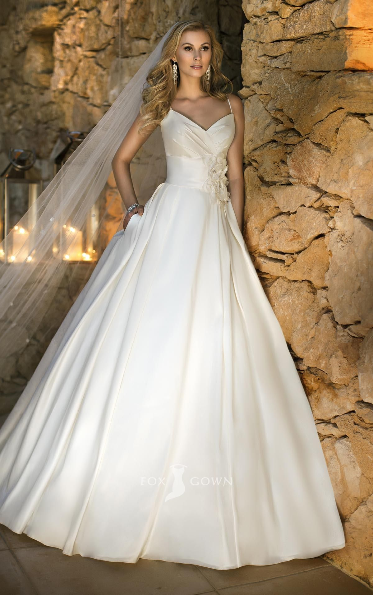 understated spaghetti strap sleeveless v neck ball gown