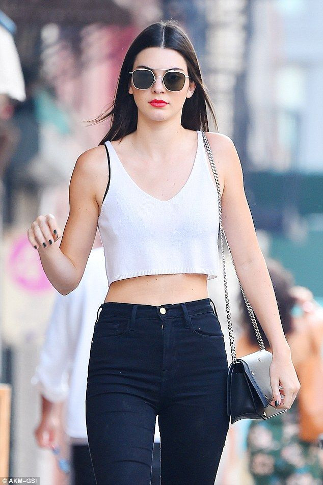 e77c40db292 Casual glam  Kendall flashed her midriff in a white crop top over a black  bra while out in New York on Friday