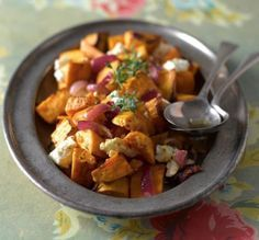 Serves 4 – 6 as a side  500g sweet potato 5 tbsp (80g) of Habanero sauce 2 tbsp olive oil Pinch of salt and pepper Pinch of dried thyme 100g feta 2 red onions cut into wedges