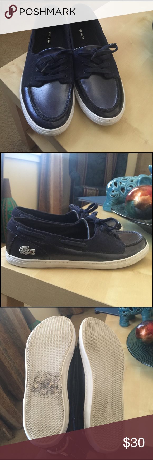 46798d09385 Navy blue with white Lacoste symbol on side of shoes. Shoe has suede upper  with final stitching, with boat style lacing. Shoes do not have original ...