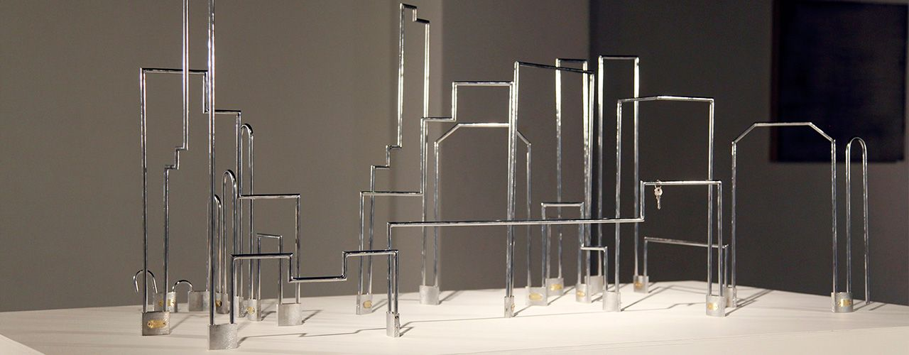 Totalitarismo, 2012 / Padlocks, silverplate metal structures and only one key in gold / Variable dimensions