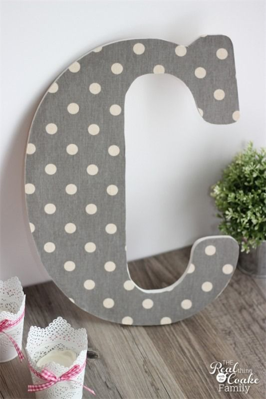 Mod podge your favorite fabric onto a big monogrammed letter for an entryway or living room.