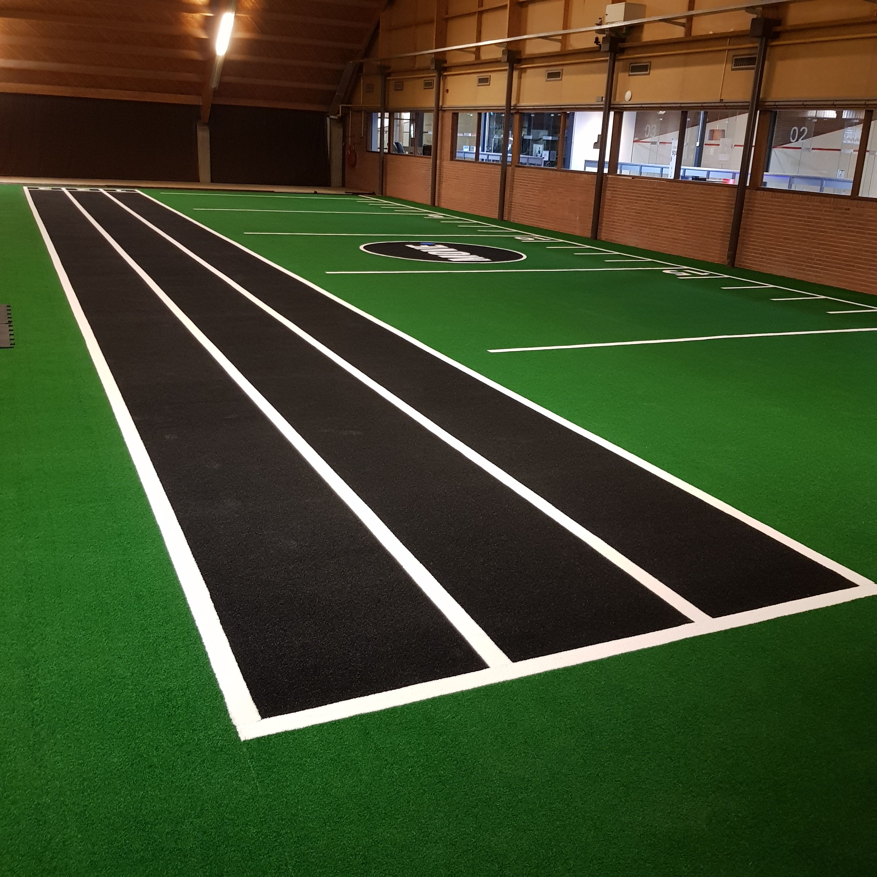 We replaced an indoor tennis court with a green and black
