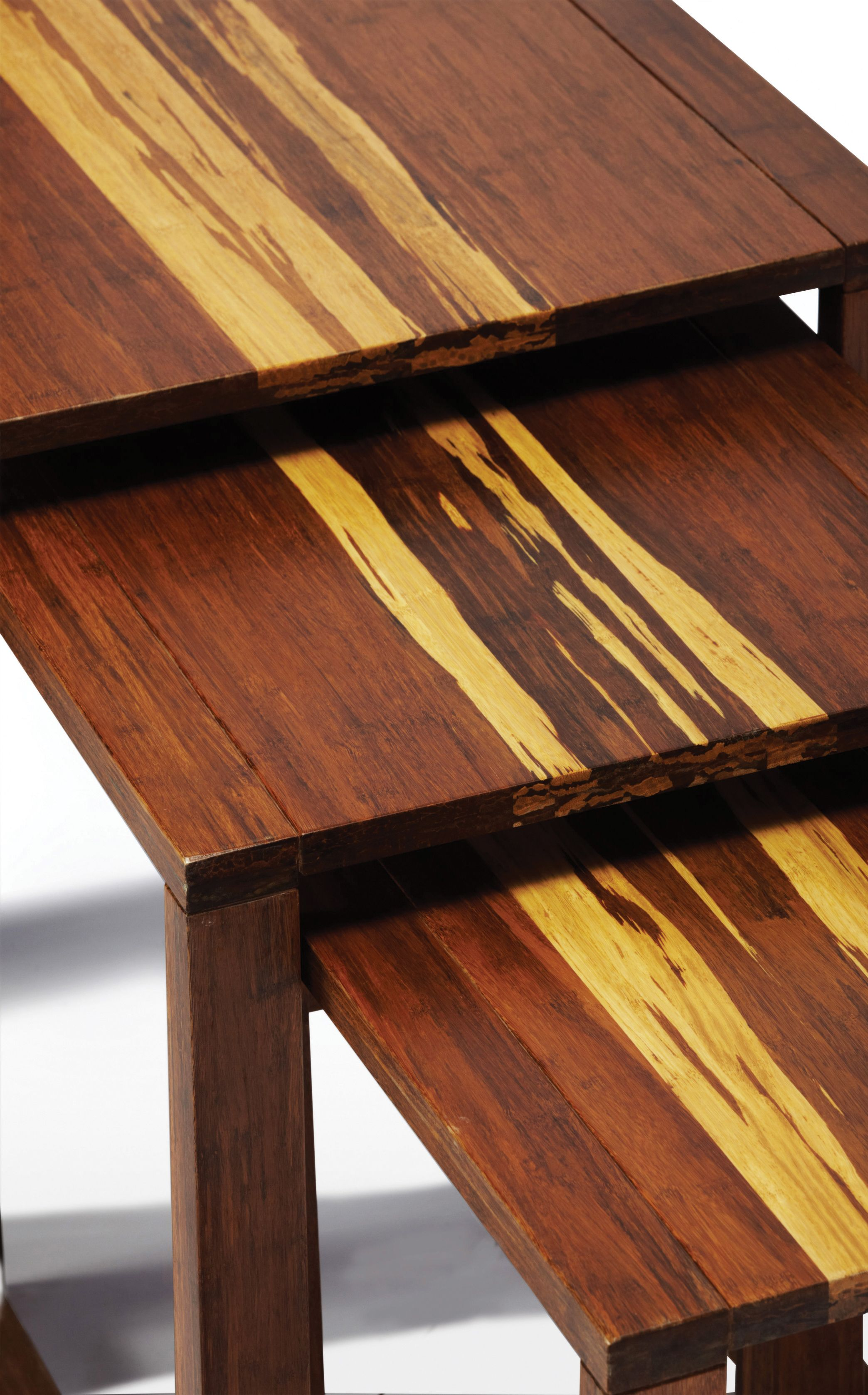 the magnolia nesting tables are crafted in solid exotic bamboo