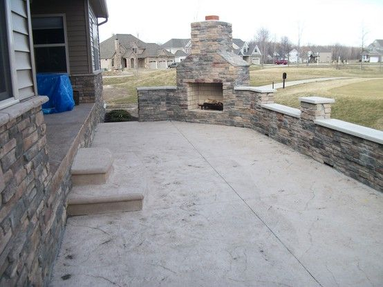 Stamped Concrete Patio With Outdoor Fire Place Concrete Steps With Bull Nose Sitting Wall Poured Concrete Patio Backyard Patio Stamped Concrete Patio
