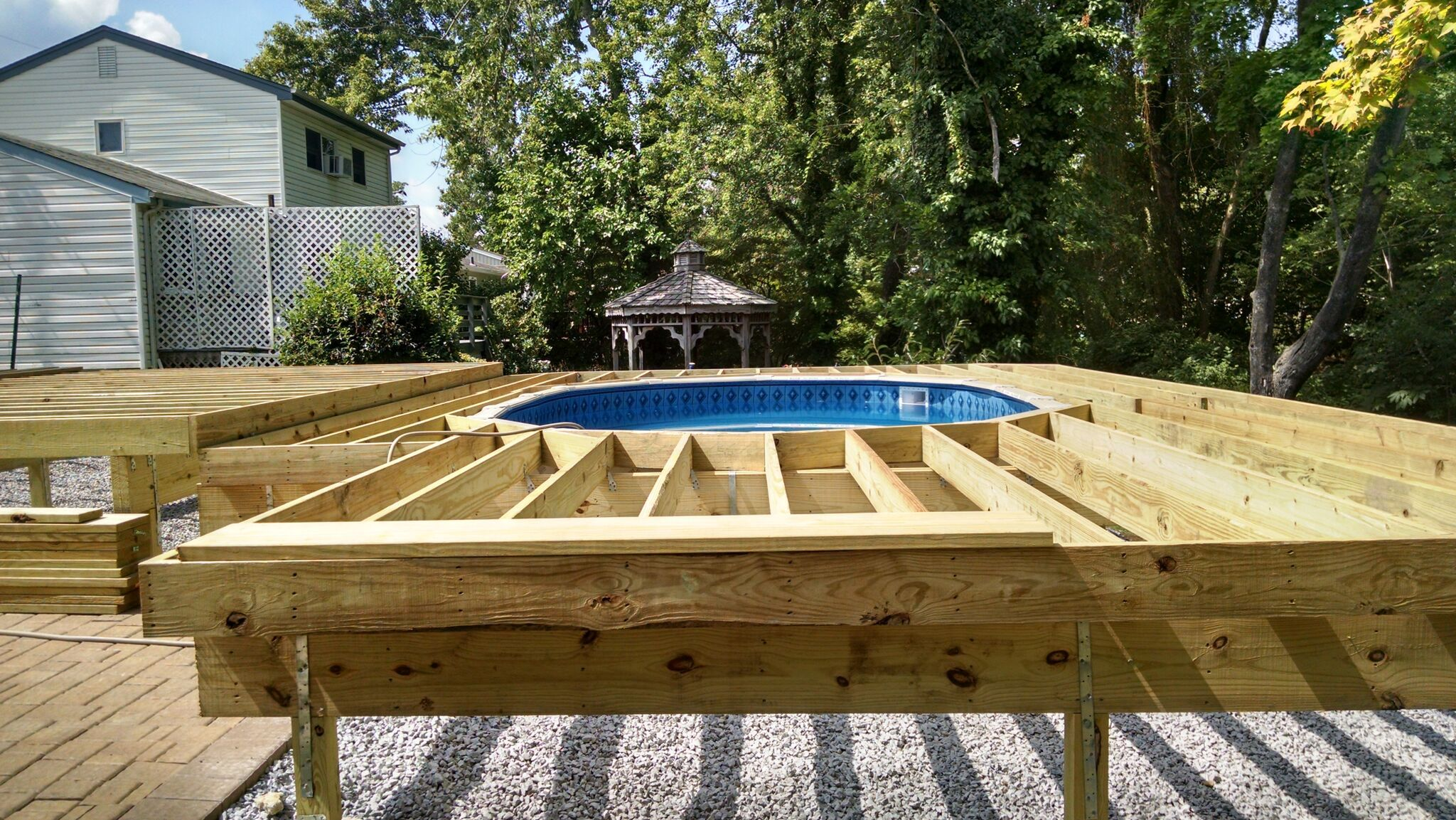 Pin By Deck And Patio Company On Decks Decks Around Pools Tiered Deck Above Ground Pool Decks