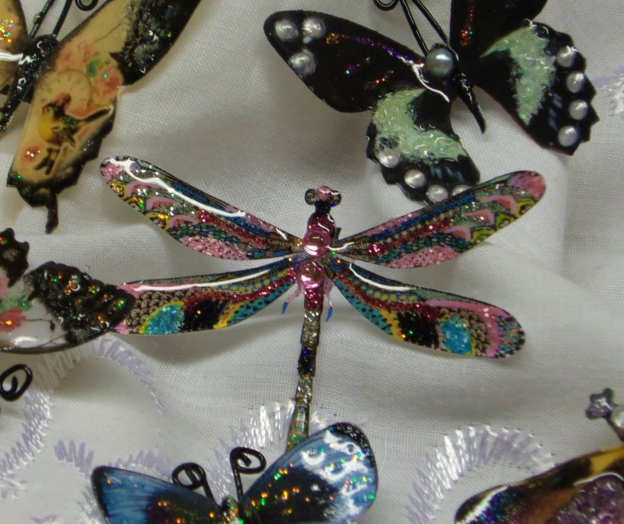 "Tutorial for these altered ReneaBouquets butterflies and dragonflies can be found on ""velocityvette08"" on Youtube!"