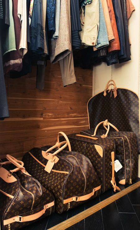 22057bda61 Andrea Stanford - Men s wood paneled closet lined with collection of Louis  Vuitton Luggage