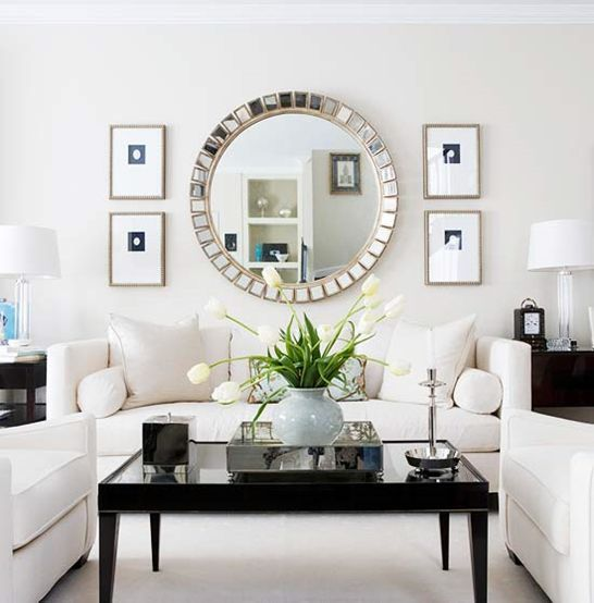 A Large Living Room To Socialise In: Round Mirror White Furniture With High Gloss Black Accents