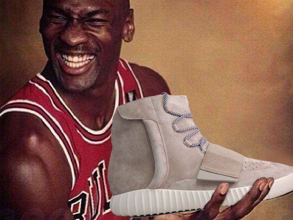 Michael Jordan laughing holding a pair of Yeezys (photoshop by The Shoe  Game)